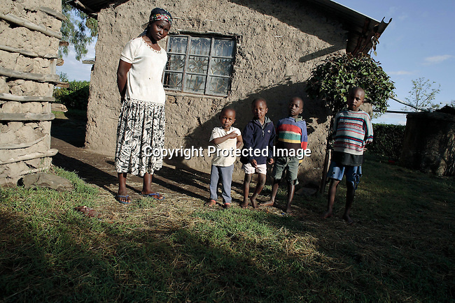 Serah Njoya stands outside her house  with her son Jack Githuka, age 3, older brothers John, age 5, Michael, age 7 and Gidrass, age 9, Photo: Per-Anders Pettersson/Getty Images