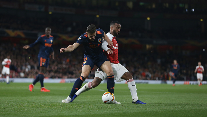 Arsenal's Alexandre Lacazette and Gabriel of Valencia<br /> <br /> Photographer Rob Newell/CameraSport<br /> <br /> UEFA Europa League Semi-final 1st Leg - Arsenal v Valencia - Thursday 2nd May 2019 - The Emirates - London<br />  <br /> World Copyright © 2018 CameraSport. All rights reserved. 43 Linden Ave. Countesthorpe. Leicester. England. LE8 5PG - Tel: +44 (0) 116 277 4147 - admin@camerasport.com - www.camerasport.com
