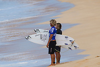 SUNSET BEACH, Oahu/Hawaii (Friday, December 5, 2014): Ricardo Christe (NZL) and caddy Ellis Erickson (AUS). The Vans World Cup of Surfing was  called ON this morning with competition begining with Round 4. <br /> A new NW 6 - 8 foot swell was on hand for the final which built through the day to 10 foot plus by the afternoon.<br /> Four island boys reached the final, three from the islands of Hawaii and one from the islands of tahiti. By the final hooter it was the Tahitian Michel Bourez (PYF) who emerged vitreous with Dusty Payne (HAW) 2nd, Sebastien Zietz (HAW) 3rd and Ian Walsh (HAW) 4th. Photo: joliphotos.com