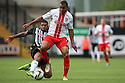 Darius Charles of Stevenage is tackled by Joss Labadie of Notts County<br />  - Notts County v Stevenage - Sky Bet League One - Meadow Lane, Nottingham - 24th August 2013<br /> © Kevin Coleman 2013