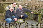Ollie Savage, John Clifford and Dan Cronin at the tombs in St Coleman's Abbey, Milltown where human remains are visible