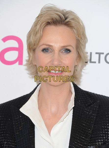 Jane Lynch.The 21st Annual Elton John AIDS Foundation Academy Awards Viewing Party held at The City of West Hollywood Park in West Hollywood, California, USA..February 24th, 2013.oscars headshot portrait black shirt suit white           .CAP/DVS.©DVS/Capital Pictures.