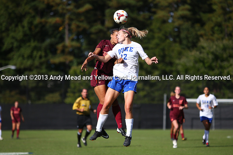 29 September 2013: Duke's Malinda Allen (22) and Virginia Tech's Candace Cephers (behind) challenge for a header. The Duke University Blue Devils hosted the Virginia Tech University Hokies at Koskinen Stadium in Durham, NC in a 2013 NCAA Division I Women's Soccer match. The game ended in a 1-1 tie after two overtimes.