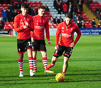 Lincoln City's Ellis Chapman,left, Scott Wharton, centre and Tom Pett during the pre-match warm-up<br /> <br /> Photographer Andrew Vaughan/CameraSport<br /> <br /> The EFL Sky Bet League Two - Lincoln City v Mansfield Town - Saturday 24th November 2018 - Sincil Bank - Lincoln<br /> <br /> World Copyright &copy; 2018 CameraSport. All rights reserved. 43 Linden Ave. Countesthorpe. Leicester. England. LE8 5PG - Tel: +44 (0) 116 277 4147 - admin@camerasport.com - www.camerasport.com