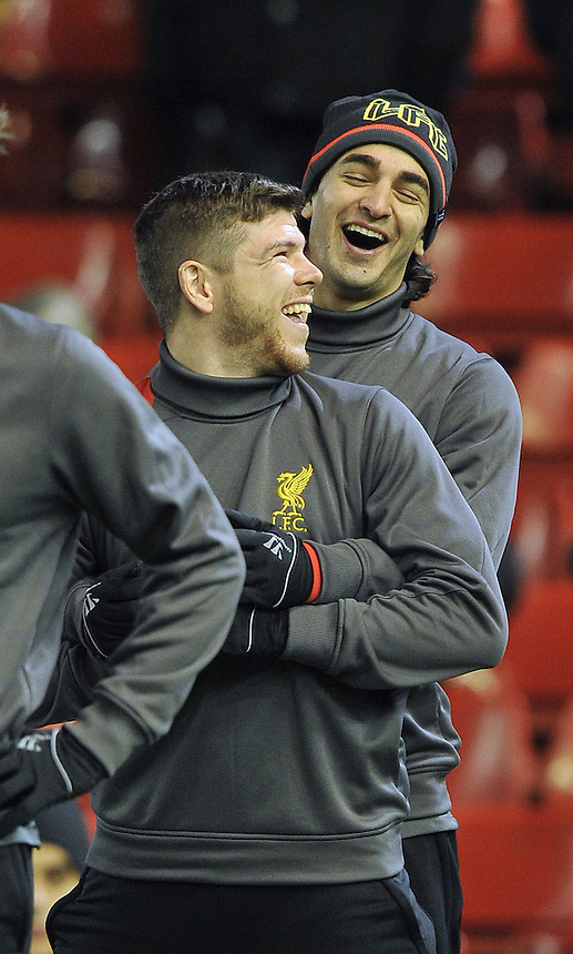 Liverpool's Alberto Moreno and Lazar Marković share a joke during warm up<br /> <br /> Photographer Dave Howarth/CameraSport<br /> <br /> Football - UEFA Champions League Group B - Liverpool v Basel - Tuesday 9th December 2014 - Anfield - Liverpool<br /> <br /> &copy; CameraSport - 43 Linden Ave. Countesthorpe. Leicester. England. LE8 5PG - Tel: +44 (0) 116 277 4147 - admin@camerasport.com - www.camerasport.com