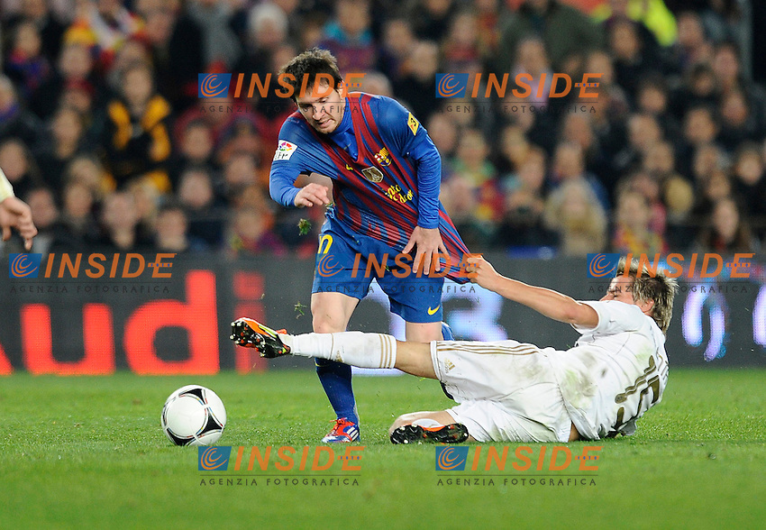 Lionel Messi (Barcellona)   Fabio Coentrao (Real Madrid) .Barcellona 25/1/2012 Nou Camp.Barcellona Real Madrid 2-2  Coppa del Re .foto Insidefoto / Paco Largo / Panoramic.Italy Only