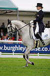 Gina Ruck [GBR] riding Rehy Too <br />  the Dressage phase of the 2014 Land Rover Burghley Horse Trials held at Burghley House, Stamford, Lincolnshire