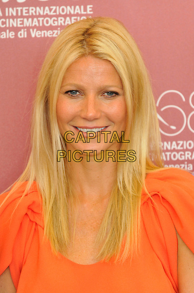 Gwyneth Paltrow.Attending the 'Contagion' photocall during the 68th Venice Film Festival, Venice, Italy, September 3rd, 2011..portrait headshot smiling beauty orange .CAP/PL.©Phil Loftus/Capital Pictures.