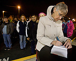 Mary Epperson, a retired police officer from Puyallup,  signs a memory book while attending a candle light prayer vigil at the Champion's Centre in Tacoma WA., for family members, friends and law enforcement officers for four Lakewood Police officers killed at a Lakewood coffee shop on Sunday, Nov. 29, 2009.  At about 8:00 a.m. Sunday morning, a gunman walked into the Forza Coffee shop and while the four police officers were having coffee before their shift started, he opened fire, killing all four law enforcement officers.  Jim Bryant Photo. ©2010. ALL RIGHTS RESERVED.