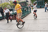 Brooklyn, NY -  3 September 2010 Unicyclists converge in City Hall Park, at the foot of the Brooklyn Bridge, for the Brooklyn Long Distance Unicycle Ride to Coney Island.