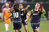 Shannon Boxx #7, Marta #10, and Camile Abilly #20 of the Los Angeles Sol celebrate a goal against Sky Blue FC during their WPS game at Home Depot Center on May 15, 2009 in Carson, California.