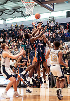 WASHINGTON, DC - NOVEMBER 16: Malik Miller #11 and Sherwyn Devonish #5 of Morgan State go up against Justin Williams #4 of George Washington during a game between Morgan State University and George Washington University at The Smith Center on November 16, 2019 in Washington, DC.
