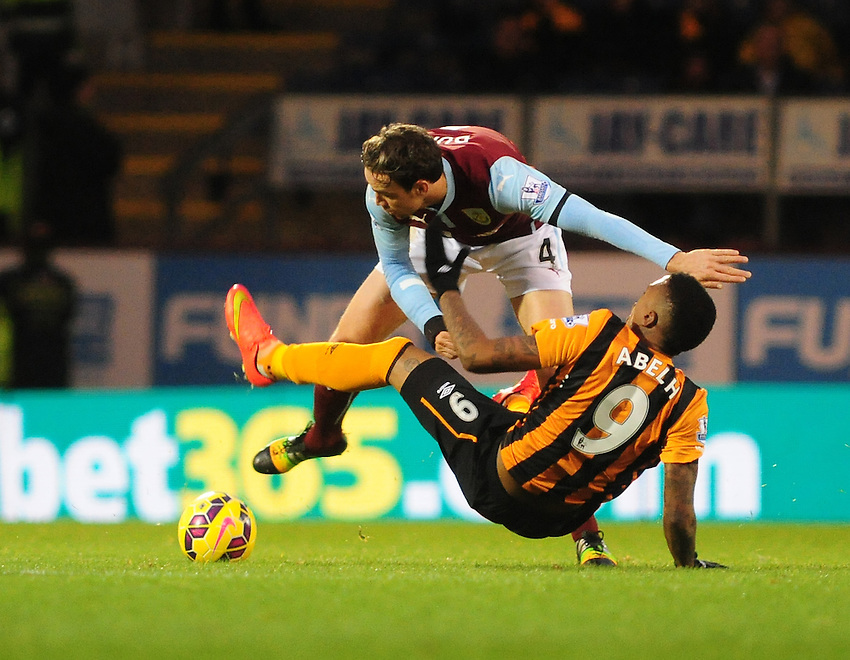Hull City&rsquo;s Abel Hernandez is fouled by Burnley's Michael Duff<br /> <br /> Photographer Chris Vaughan/CameraSport<br /> <br /> Football - Barclays Premiership - Burnley v Hull City - Saturday 8th November 2014 - Turf Moor - Burnley<br /> <br /> &copy; CameraSport - 43 Linden Ave. Countesthorpe. Leicester. England. LE8 5PG - Tel: +44 (0) 116 277 4147 - admin@camerasport.com - www.camerasport.com