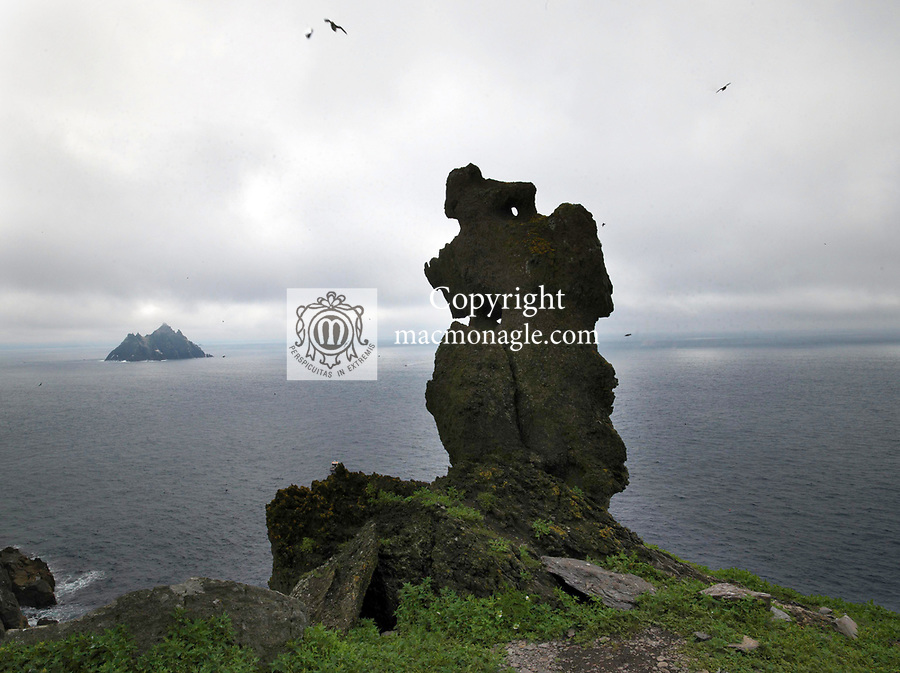 The 'wailing woman' stands firm against the Wild Atlantic Winds on Skellig Michael, the greater of the Skellig Rocks.<br /> Photo: Don MacMonagle