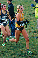 With blood dripping down both legs after getting knocked down and stepped on by competitors spiked shoes, Mizzou freshman Kaitlyn Fischer runs midway through the women's 6k race at the 2013 NCAA Division I Cross Country National Championships in Terre Haute, Saturday, November 23. Fischer recovered to finish 79th in the field of 254, in a time of 21:10. Fischer was the 12th best freshman finisher.