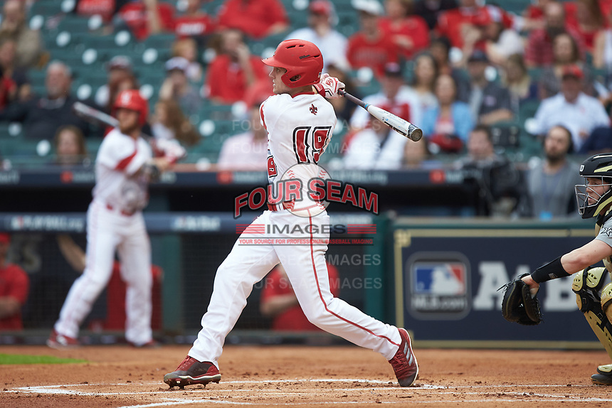 Hunter Kasuls (19) of the Louisiana Ragin' Cajuns follows through on his swing against the Vanderbilt Commodores in game five of the 2018 Shriners Hospitals for Children College Classic at Minute Maid Park on March 3, 2018 in Houston, Texas.  The Ragin' Cajuns defeated the Commodores 3-0.  (Brian Westerholt/Four Seam Images)