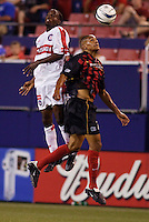 The Chicago Fire's DaMarcus Beasley and the MetroStars' Ricardo Clark go up for a header. The Chicago Fire played the NY/NJ MetroStars to a one all tie at Giant's Stadium, East Rutherford, NJ, on May 15, 2004.