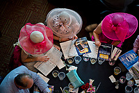 LOUISVILLE, KY - MAY 05: Women work on handicapping a race while wearing their fanciest pink hats on Kentucky Oaks Day at Churchill Downs on May 5, 2017 in Louisville, Kentucky. (Photo by Scott Serio/Eclipse Sportswire/Getty Images)