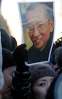 A woman holds a picture of Liu Xiaobo during  protest outside the Chinese emabassy in Oslo..The Norwegian Nobel Committee decided to award the Nobel Peace Prize for 2010 to Liu Xiaobo. In a press conference in Oslo on Dec 9 , 2010, Director Geir Lundestad (left) and leader of the Norwegian Nobel Committee Thorbjørn Jagland elaborated on their decision to award the prize to Xiaobo...Representatives from the Embassy of the People's Republic of China in Oslo would not meet activists from many countries later that afternoon when they, together with Amnesty International, tried to hand over nearly 100.000 signatures in support of the release of the Nobel Peace Prize Laureate Liu Xiaobo. ..Photo: Fredrik Naumann/Felix Features