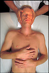 hands massaging patient's head