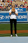 LOS ANGELES, CA. - September 19: Jenna Elfman before throwing the ceremonial first pitch at the Dodger game at Dodger Stadium on September 19, 2009 in Los Angeles, California.