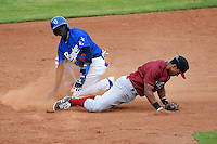 Faustino Oguisten #10 of the Ogden Raptors takes out Idaho Falls Chukars second baseman Carlos Garcia  #8 with a slide at second base during the Pioneer League game at Lindquist Field on June 23, 2013 in Ogden, Utah. (Stephen Smith/Four Seam Images)