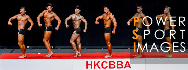 A bodybuilder competes in the South China Men's Athletic Physique over 173cm (Round 2) category during the 2016 Hong Kong Bodybuilding Championships on 12 June 2016 at Queen Elizabeth Stadium, Hong Kong, China. Photo by Lucas Schifres / Power Sport Images