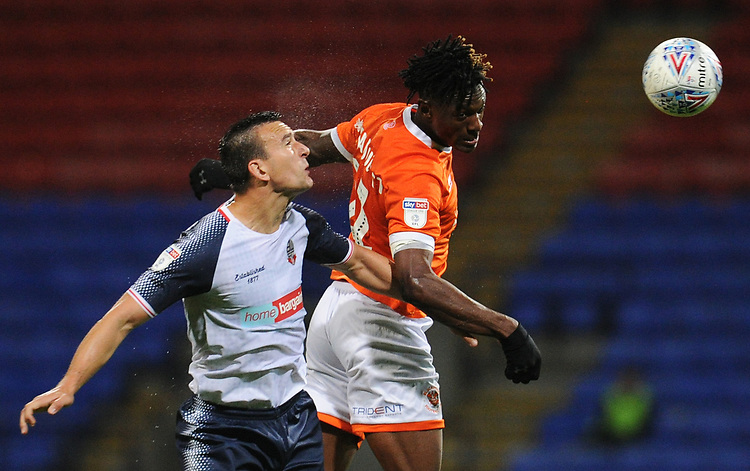 Blackpool's Armand Gnanduillet vies for possession with Bolton Wanderers' Jack Hobbs<br /> <br /> Photographer Kevin Barnes/CameraSport<br /> <br /> The EFL Sky Bet League One - Bolton Wanderers v Blackpool - Monday 7th October 2019 - University of Bolton Stadium - Bolton<br /> <br /> World Copyright © 2019 CameraSport. All rights reserved. 43 Linden Ave. Countesthorpe. Leicester. England. LE8 5PG - Tel: +44 (0) 116 277 4147 - admin@camerasport.com - www.camerasport.com
