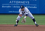 Nevada Wolf Pack shortstop Joshua Zamora makes the play on a ground ball against the Reno Aces at Greater Nevada Field in downtown Reno, Nevada on Tuesday, April 2, 2019.