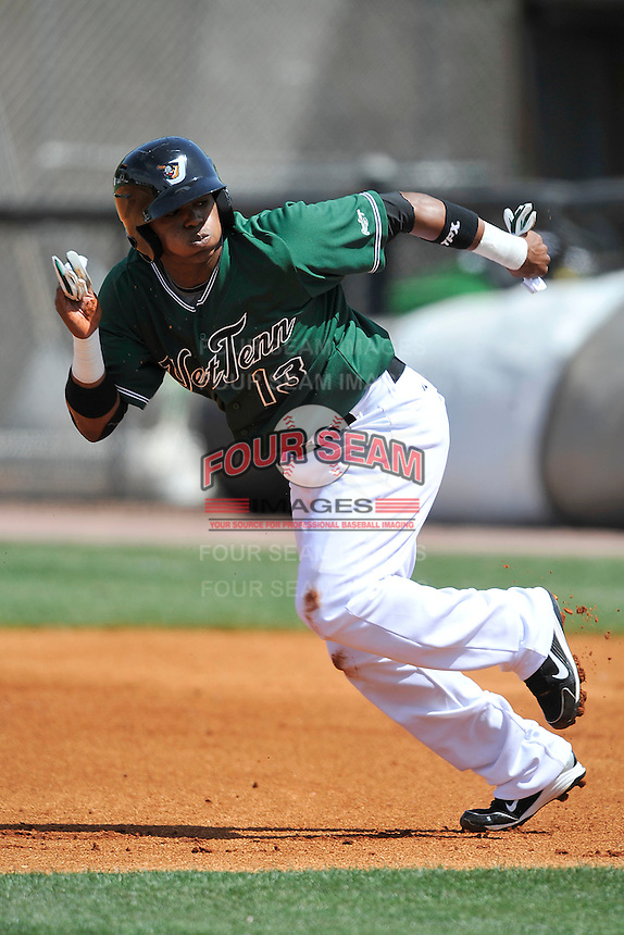 Carlos Triunfel #13 of the West Tenn Diamond Jaxx in action versus the Mississippi Braves at Pringles Park April 18, 2010 in Jackson, Tennessee. (Photo by Grant Halverson / Four Seam Images)