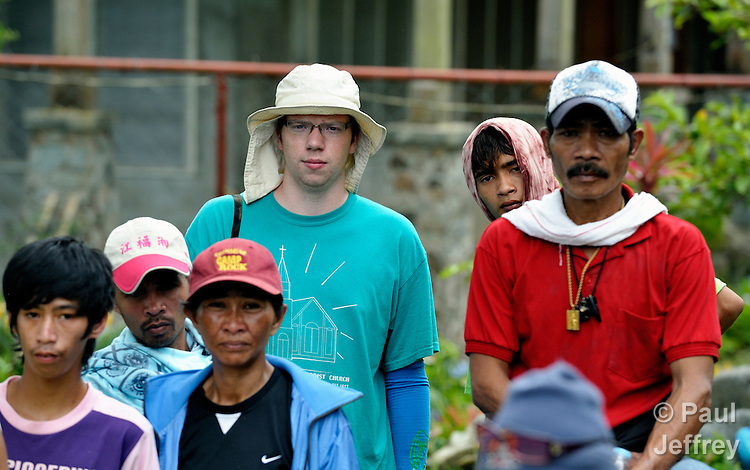 Adam Shaw, a United Methodist mission intern, observes a June 4, 2012, rally of small-scale miners in a protest outside the Mt. Diwata offices of the Philippine Mining Development Corporation, a front company for foreign mining companies that seeks to install a large-scale open pit gold mine in the Diwalwal area on the Philippines' southern island of Mindanao. The miners were given a notice to evacuate the area by June 5 or risk being forcibly removed by the military. They have defiantly refused to leave. Shaw is assigned to INPEACE-Initiatives for Peace in Mindanao..