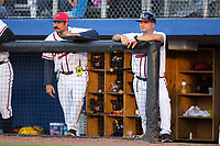 Danville Braves pitching coach Kanekoa Texeira (left) and manager Nestor Perez (right) watch the action from the dugout during the game against the Elizabethton Twins at American Legion Post 325 Field on July 1, 2017 in Danville, Virginia.  The Twins defeated the Braves 7-4.  (Brian Westerholt/Four Seam Images)