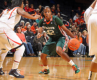Jan. 6, 2011; Charlottesville, VA, USA; Miami Hurricanes guard Shenise Johnson (42) handles the ball in front of Virginia Cavaliers guard Paulisha Kellum (3) during the game at the John Paul Jones Arena.  Mandatory Credit: Andrew Shurtleff-