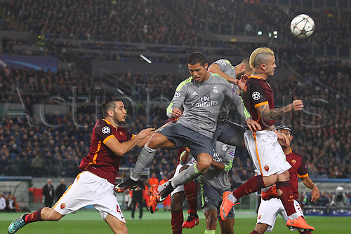 17.02.2016. Stadio Olimpico, Rome, Italy. UEFA Champions League, Round of 16 - first leg, AS Roma versus Real Madrid. Benzema and Ronaldo are beaten to the cross by Roma defender Radja Nainggolan