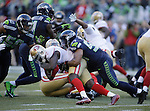 Seattle Seahawks linebacker Bobby Wagner (54) drags down San Francisco 49ers running back Frank Gore (21  at CenturyLink Field in Seattle, Washington on December 14, 2014. The Seahawks beat the San Francisco 49ers 17-7.  @2014. Jim Bryant Photo.  All Rights Reserved.