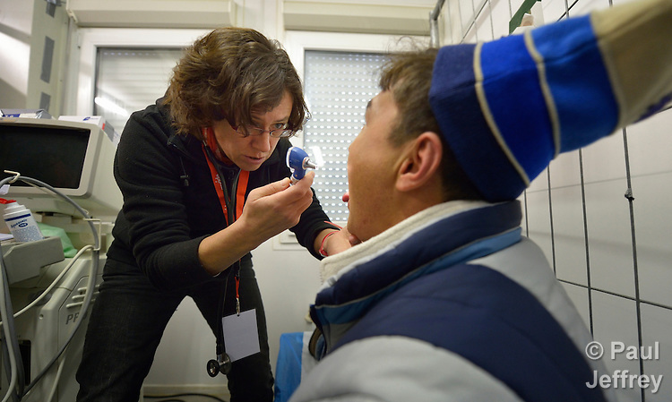 Physician Maria Kratewald examines an Afghan refugee in a clinic in the Hauptbahnhof railroad station in Vienna, Austria, where asylum seekers--and the volunteers who welcome them--congregate.