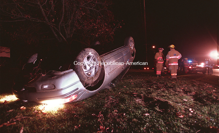WOODBURY, CT 11/10/08 --1110JH02.tif--A Dodge Stratus lies in its roof after an accident Tuesday evening along Route 6 in Woodbury. JOHN HARVEY staff photo for Gardner story.