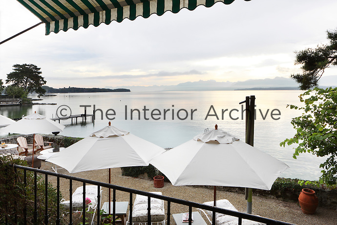 Views of a serene Lake Geneva seen from one of the balconies above the outdoor seating area