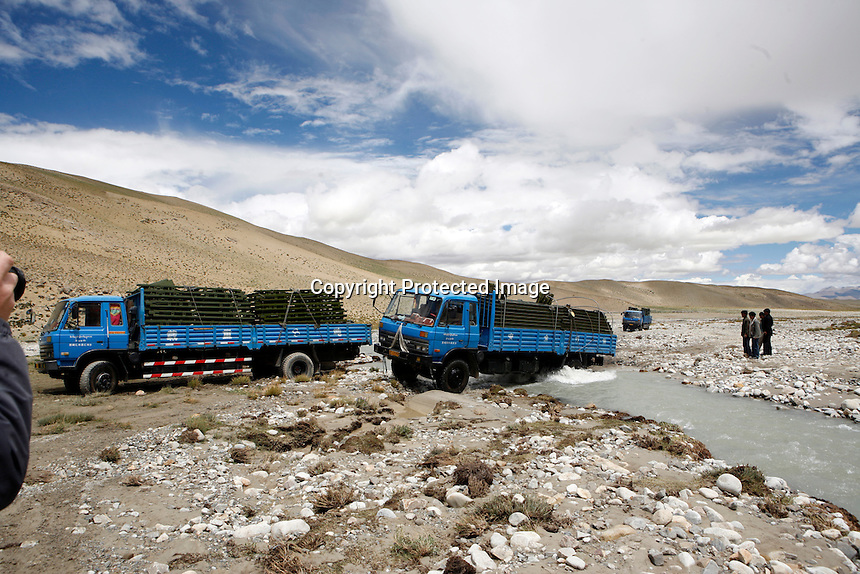 "The road from Old Tingri to Everest Base Camp.<br /> China started building a controversial 67-mile ""paved highway fenced with undulating guardrails"" to Mount Qomolangma, known in the west as Mount Everest, to help facilitate next year's Olympic Games torch relay."