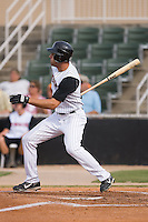Jordan Danks (13) of the Kannapolis Intimidators follows through on his swing at Fieldcrest Cannon Stadium in Kannapolis, NC, Saturday August 24, 2008. (Photo by Brian Westerholt / Four Seam Images)