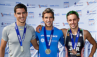 25 MAR 2012 - LOUGHBOROUGH, GBR - Mark Buckingham (Holmfirth Harriers) (centre) celebrates winning the 2012 British Elite Men's Duathlon Championship title at Prestwold Hall Airfield in Prestwold near Loughborough, Great Britain with silver medalist Matthew Gunby (PACTRAC) (left) and bronze medalist Lawrence Fanous (Jordan Triathlon) (right) (PHOTO (C) 2012 NIGEL FARROW)