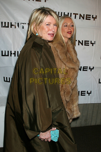 MARTHA STEWART & GUEST.The 2006 Whitney Gala celebrating Picasso and Modern Art at the Whitney Museum, New York, NY, USA..October 23rd, 2006.Ref: IW.half length green coat.www.capitalpictures.com.sales@capitalpictures.com.©Ian Wilson/Capital Pictures