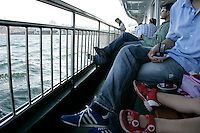 Passengers on an Istanbul ferry on the Golden Horn, Istanbul, Turkey