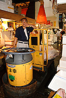 Portraits of people who work at Tsukiji fish market, Tokyo, Japan, August 4, 2008. The Tokyo Metropolitan Central Wholesale Market, better known as Tsukiji market, is the largest fish market in the world. Tsukiji is both a popular tourist attraction and a Mecca of Japanese food culture.
