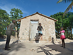 Erm Jouna Dalmas, 10, jumps rope in front of her family's new house on the Haitian island of La Gonave. Her siblings Vestander and Erm hold the rope. Service Chr&eacute;tien d&rsquo;Ha&iuml;ti is working with survivors of Hurricane Matthew, which struck the region in 2016, to rebuild damaged housing. A member of the ACT Alliance, SCH also supports agriculture on the island by providing tools, seeds, and technical support and training for farmers.<br /> <br /> Parental consent obtained.