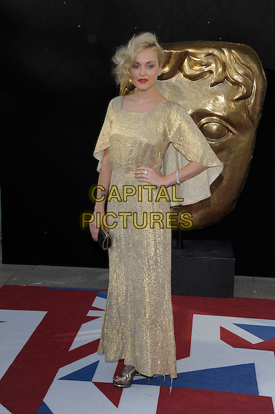 Fearne Cotton.Arrivals at the Arqiva British Academy Television Awards held at the Royal Festival Hall, London, England..May 27th, 2012.BAFTA BAFTAS full length gold dress clutch bag hand on hip.CAP/PL.©Phil Loftus/Capital Pictures.