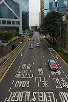 Red taxi cabs on highway in Hong Kong
