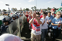 United States fans cheer and chant as they leave Azteca Stadium under a police escort. Mexican police officers in riot gear separated the team's fan supporters to prevent any violence. The United States Men's National Team played Mexico in a CONCACAF World Cup Qualifier match at Azteca Stadium in, Mexico City, Mexico on Wednesday, August 12, 2009.