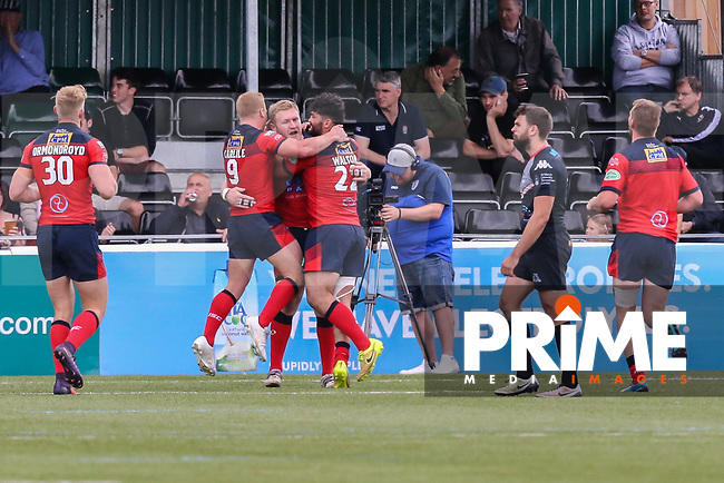 Andy Bostock of Featherstone Rovers (centre) celebrates after he scores a try during the Kingstone Press Championship match between London Broncos and Featherstone Rovers at Castle Bar , West Ealing , England  on 25 June 2017. Photo by David Horn.