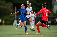 Seattle, WA - Saturday, July 02, 2016: Seattle Reign FC forward Manon Melis (14) and Boston Breakers goalkeeper Jami Kranich (2) during a regular season National Women's Soccer League (NWSL) match between the Seattle Reign FC and the Boston Breakers at Memorial Stadium.